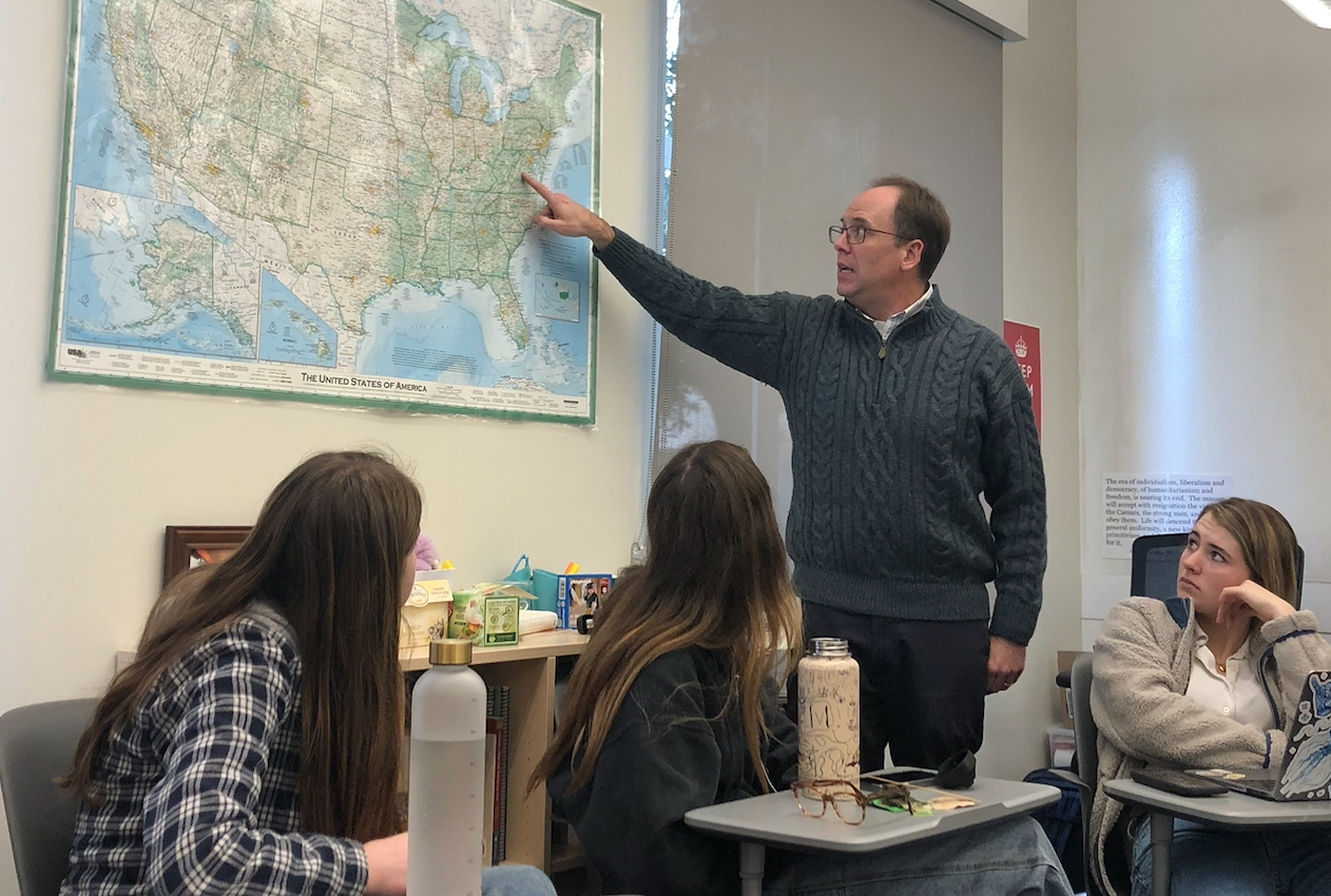History teacher Michael Stafford points to the different states where the battles occurred. Stafford led a lecture before showing a Ken Burns documentary.