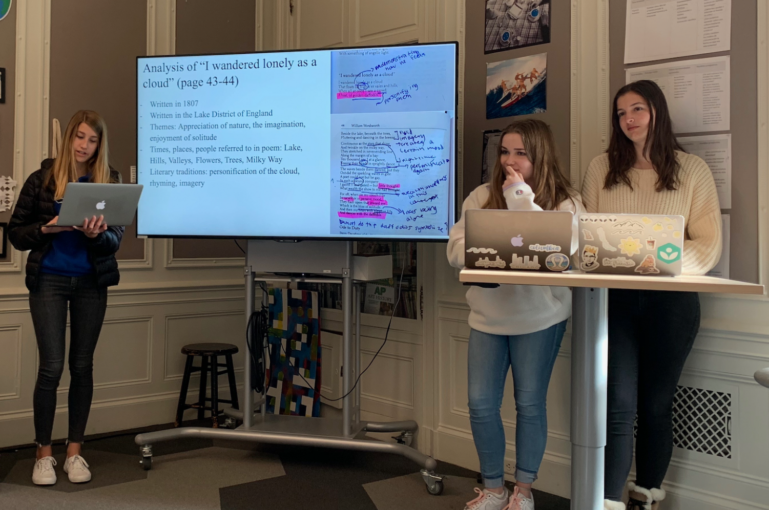 """Sophomores Bridget Mills, Sloane Riley, and Cristina Jackson analyze """"I wandered lonely as a cloud"""" in their presentation of the poet William Wordsworth. The students were also asked to research about the poets life including where they lived and important relationships in their life."""