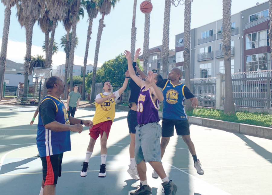 Special Olympics athletes play basketball amongst student volunteers. Sports seasons change year round and include more than 30 options such as swimming, basketball and skiing.