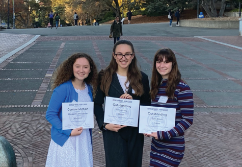 Sophomore Mackenna Moslander and juniors Lili Levy and Tara Boyd show off their awards from the Model UN conference in November. Awards are given to individual delegations for their work with personal directives and public speaking.