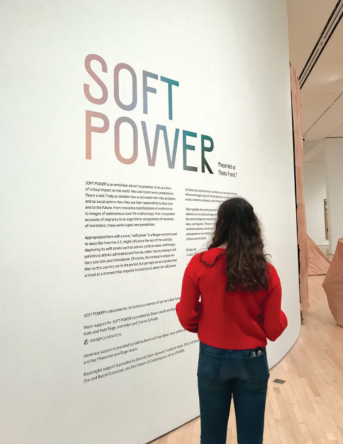 Senior Estie Seligman reads the Soft Power exhibit description at the San Francisco Museum of Modern Art. The Soft Power exhibit touches on politics and injustices through photographs, films, and abstract painting.