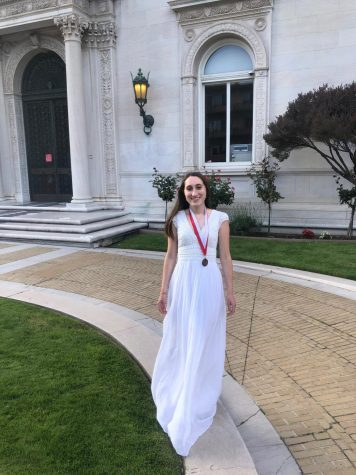 Graduate Gabriella Vulakh stands outside the Flood Mansion today before going inside to deliver her Salutatorian address. The Class of 2020 had a virtual commencement this afternoon through Zoom.