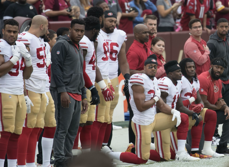 San Francisco 49ers players kneel during the national anthem to protest police brutality and racial injustice at a game in 2017. This was one form of protest in sports used three years ago that members of certain teams, such as the San Francisco Giants, employ today.