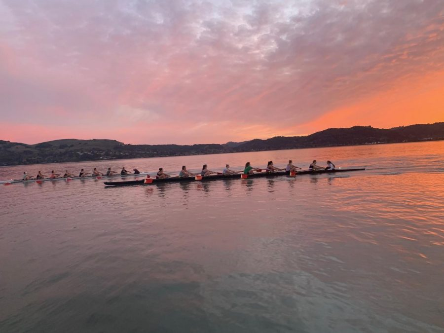 Senior Ella Ghazinouri practices with Marin Rowing Association in Greenbrae during sunset. Ghazinouri is contacting Division-I coaches virtually since the NCAA has banned in-person recruitment.