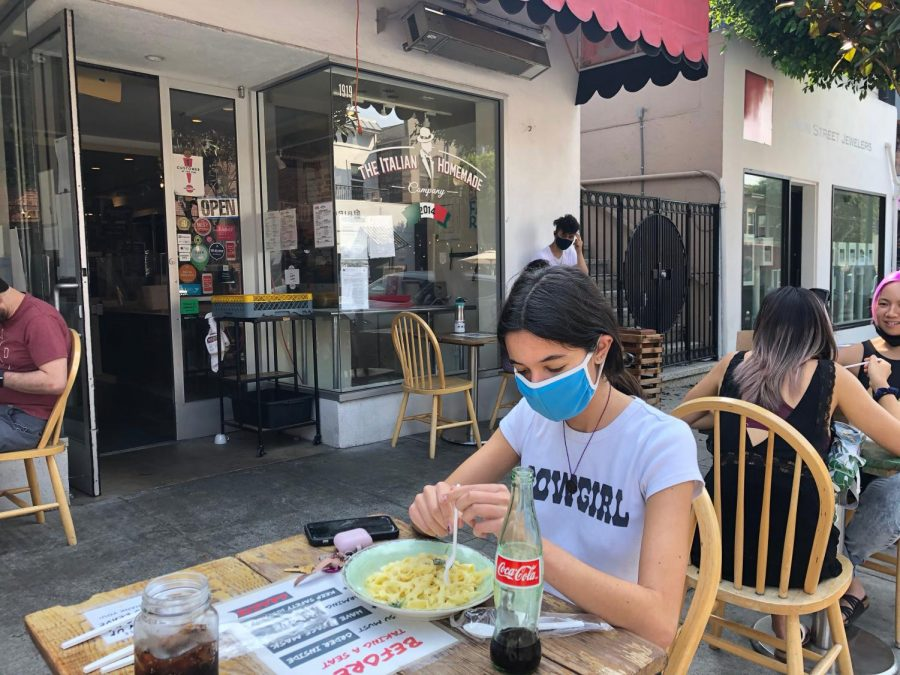Junior Haya Jadallah eats at Italian Homemade on Union Street in an outdoor dining area. Restaurants opened outdoor seating to public with safety precautions.