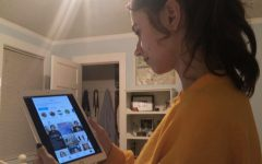 Junior Lily Peta scrolls through representative Alexandria Ocasio-Cortez's instagram account. Many politicians use social media as a way to reach out to their supporters and share their views.