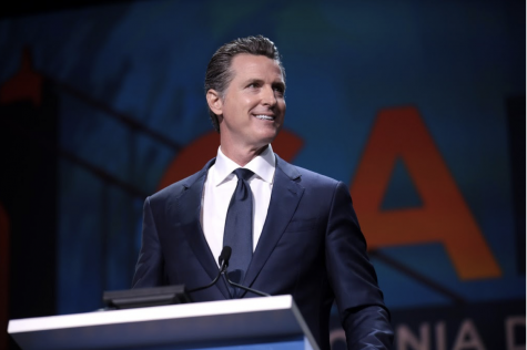 Governor Gavin Newsom addresses attendees at the 2019 California Democratic Party State Convention. Recently the governor signed an executive order banning gasoline cars by 2035.