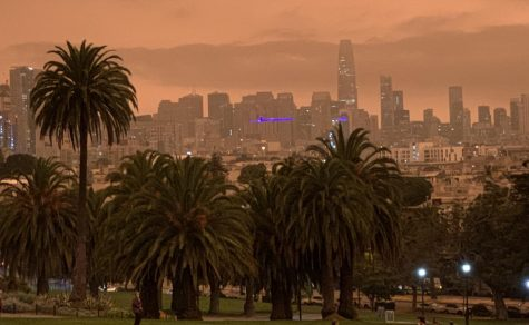An orange haze resting over downtown San Francisco is visible from Dolores Park on the morning of Sept. 9. Despite the smoky skies, air quality was considered moderate across most of the City according to the Environmental Protection Agency.