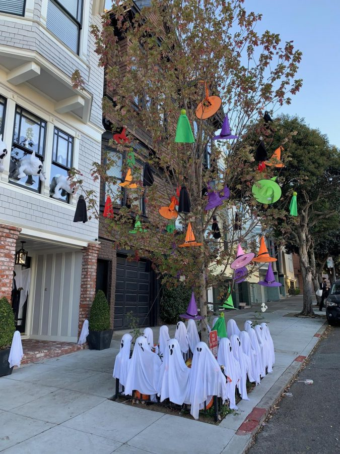 Residents at 447-449 Spruce St. arrange their ghostly decorations in a not-so-socially distant presentation.