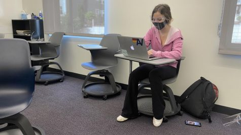 Sophomore Amalyia Sypult sits in her classroom with a mask and face shield on for protection. The San Frnacisco Department of Public Health made a surprise visit today to make sure students and faculty are wearing masks at all times and face shields when less than 6 feet apart from another person.