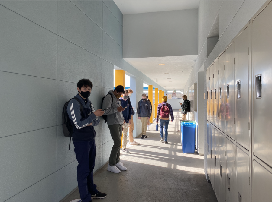 Students socially distance while they wait for class to begin on the Pine/Octavia campus. Convent & Stuart Hall have already gained clearance to remain open, so the school may continue to provide in-person learning for their students through the stay-at-home order.