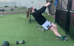 Senior Cecilia Mcquid works out on Syufy Court. Mcquid attends workouts twice a week since it was offered on Nov. 16.