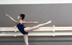 Junior Lily Peta balances in arabesque in a San Francisco Ballet School studio. SF Ballet studios were opened to company members, school levels seven, eight and trainee in October after being closed since March.
