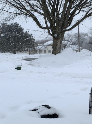 Ethics & Morality teacher Clint Hackenberg's front porch of his family home in Ohio is covered by 6 ft snow. Extreme cold weather caused power to go out, leaving homes without heat and causing pipes to burst.