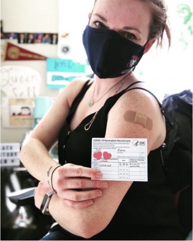 Librarian Reba Sell shows off her vaccination record card. California has moved into vaccinating individuals in Category 1B, which includes childcare workers and adults working in K-12 institutions.