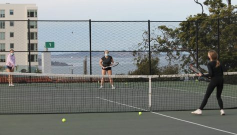 Juniors Amelia Abernethy, Sloane Riley and Paige Retajczyk practice in their cohort at the Alice Marble Tennis Courts at George Sterling Park on Feb. 12. Season 1 sports, including cross-country, golf and tennis, began on Feb. 8.