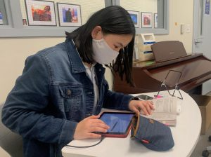 Sophomore Sophia Wu uses an iPad to take notes during an Honors English class. Many students use apps such as Notability to create and download organized digital class notes.