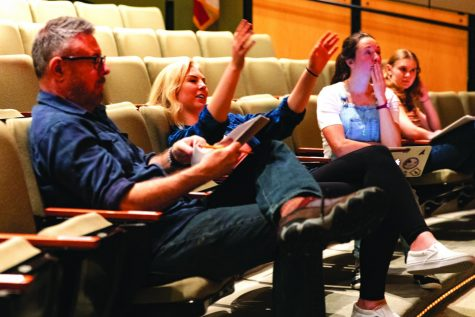 "Senior Anya Hilpert sits between theater manager Chris Miller and Theater Programs Director Margaret Grace Hee as Hilpert gives directions to actors on stage for ""She Kills Monsters"" in fall 2019."