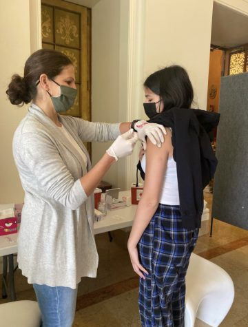 Sophomore Sophia Davis receives her first dose of the Pfizer COVID-19 Vaccine on the Broadway campus. Convent's vaccine appointments opened up to those of 12 and up after the CDC approval of it on May 12.