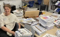 Scholastic Journalism & Media Director Tracy Sena sits by stacks of The Broadview as she cleans out the Publications Lab before retiring. Sena has advised The Broadview for more than two decades and has overseen newspapers for both high school divisions, Convent Elementary and the yearbooks.