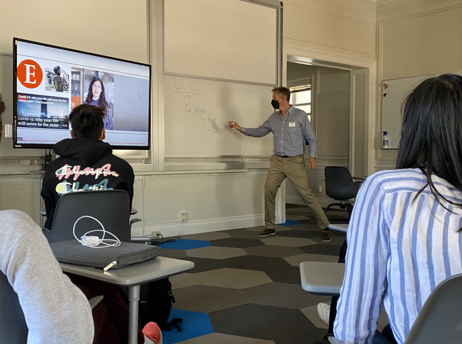 IB Global politics teacher Martin Jorgensen shares a video about conflict in the Middle East during class. Many teachers went over syllabi and introductions of the course to prepare students for the school year.