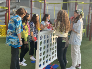 A group of freshmen gather on Syufy Court to play connect-four during the Carnival. The theme was tropical glow and the event ran from 6-8p.m.