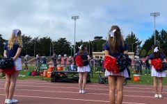 The newly established cheerleading squad roots on the football team during Saturday's game. The Knights lost 22-20 to Woodside Priory School.