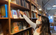 Senior Mira Chawla browses the shelves of Browser Books on Fillmore Street. The store is one of three locations owned by Green Apple Books, who have once again opened their doors to the community for literary events and shopping.