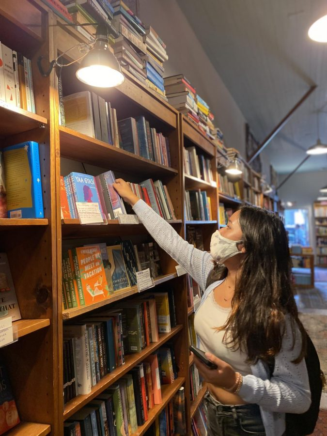 Senior+Mira+Chawla+browses+the+shelves+of+Browser+Books+on+Fillmore+Street.+The+store+is+one+of+three+locations+owned+by+Green+Apple+Books%2C+who+have+once+again+opened+their+doors+to+the+community+for+literary+events+and+shopping.