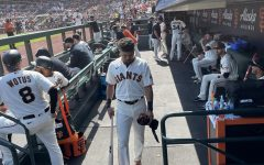 Outfield LaMonte Wade Jr. returns to the clubhouse from the dugout. The Giants have already clinched a sport in the 2021 postseason.