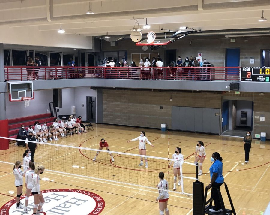 Student spectators cheer on the varsity volleyball team as they enter the third set of the match. The Athletics Department has permitted student attendance of all volleyball home games.