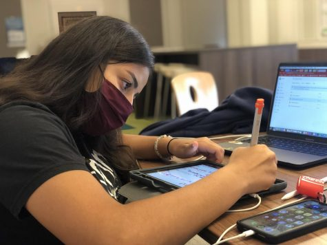 Junior Sofia Karti works on classwork on the app Notability. Students were administered iPads with predownloaded apps for note-taking.